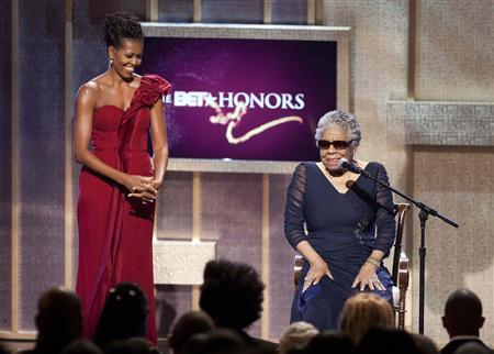First Lady Michelle Obama (L) stands by BET honoree author Maya Angelou at the BET Honors in Washington January 14, 2012.