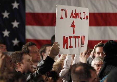 A supporter of Republican presidential candidate and former Massachusetts Governor Mitt Romney holds up a sign as he meets with supporters at the Hall at Senate's End in Columbia, South Carolina, January 11, 2012. Credit: Reuters/Jason Reed
