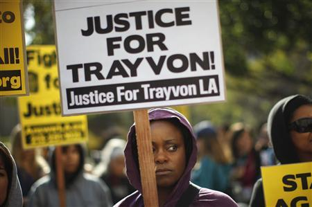 Ebony Fay holds up a sign during rally preceding the Million Hoodies March, to protest the failure of police to arrest a Florida neighborhood watch volunteer for shooting to death an unarmed black teenager, Trayvon Martin, in Los Angeles, California, March 26, 2012. REUTERS/David McNew