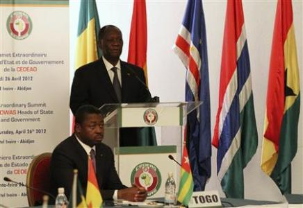 Ivory Coast's   President Alassane Ouattara, chairman of the Economic Community of West African States (ECOWAS), speaks during an ECOWAS   meeting to discuss on the Mali crisis and Guinea-Bissau's coup, in Abidjan April 26, 2012. At left is Togo's President   Faure Gnassingbe. REUTERS/Luc Gnago