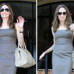 Angelina shows off her new engagement ring