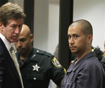 Attorney Mark O'Mara (L) looks on George Zimmerman   (R) makes his first appearance on second degree murder charges in the shooting death of Trayvon Martin in courtroom J2 at the   Seminole County Correctional Facility in Sanford, April 12, 2012. REUTERS/Gary W. Green/Pool