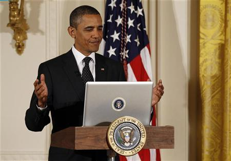 U.S. President Barack Obama reacts after tweeting at   his first ever Twitter Town Hall in the East Room at the White House in Washington, July 6, 2011. REUTERS/Larry Downing