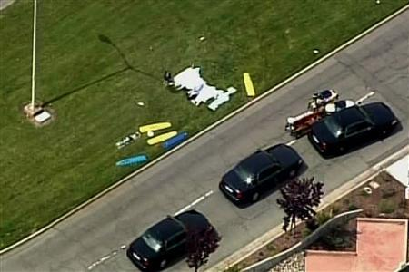 Gurneys are placed on a stretch of grass outside a private   Christian college after a gunman entered the facility in Oakland, California, April 2, 2012 in this still image taken from   video. REUTERS/Reuters TV/KNTV/Handout