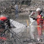 RCMP underwater recovery team members locate debris from one of two airplanes involved in a mid-air crash near St. Brieux. Five people died in the crash Saturday but little information is available about what caused the tragedy. Photograph by: Richard Marjan, The StarPhoenix , The StarPhoenix
