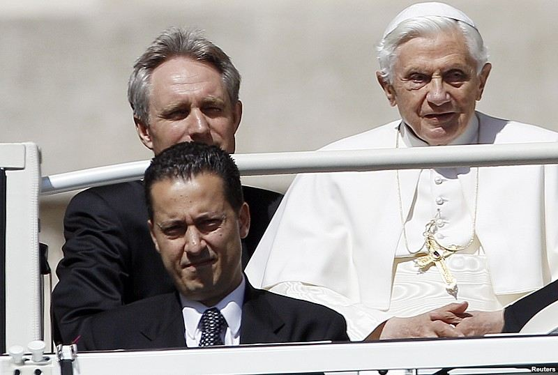 The Pope's butler, Paolo Gabriele (bottom L) arrives with Pope Benedict XVI (R) at St. Peter's Square in Vatican, in this file photo taken May 23, 2012.