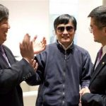 A handout photo from US Embassy Beijing Press office shows blind activist Chen Guangcheng (C) shaking hands with U.S. Ambassador to China Gary Locke (R), in Beijing, May 2, 2012. REUTERS/US Embassy Beijing Press Office/Handout