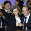 France's newly-elected President Francois Hollande (R) and his companion Valerie Trierweiler celebrate on stage during a victory rally at Place de la Bastille in Paris early May 7, 2012. France voted in elections on Sunday and Francois Hollande becomes the nation's first Socialist president in 17 years. REUTERS/Charles Platiau (FRANCE - Tags: POLITICS ELECTIONS)