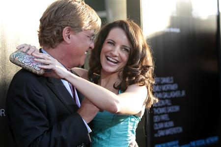 "Creator and executive producer Aaron Sorkin and actress Kristin Davis pose at the premiere of the HBO television series ""The Newsroom"" at the Cinerama Dome in Los Angeles, California June 20, 2012. REUTERS/Mario Anzuoni"