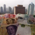 Different values of China's yuan banknotes are placed on a window sill as Shanghai's skyscrapers are seen in the background, in this April 15, 2012 file photo illustration taken in Shanghai. REUTERS/Petar Kujundzic/Files