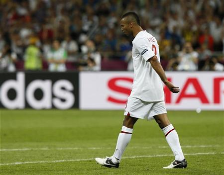 England's Ashley Cole reacts after missing a penalty during the penalty shoot-out in their Euro 2012 quarter-final soccer match against Italy at the Olympic Stadium in Kiev, June 24, 2012. REUTERS/Tony Gentile