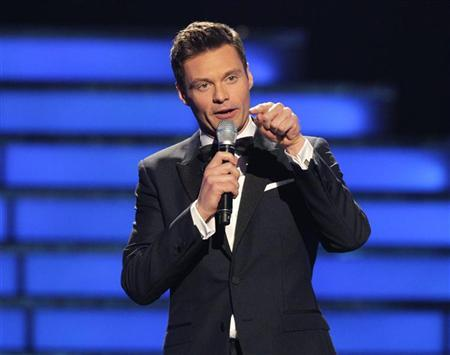 """Host Ryan Seacrest presides over the 11th season finale of """"American Idol"""" in Los Angeles, California, May 23, 2012. REUTERS/Mario Anzuoni"""