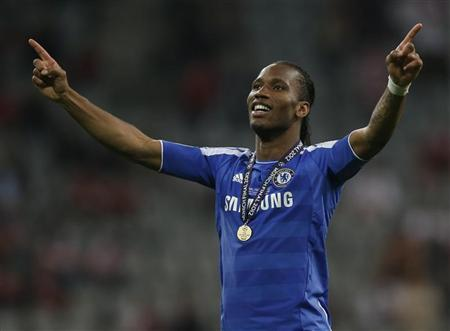 Chelsea's Didier Drogba celebrates victory in their Champions League final soccer match against Bayern Munich at the Allianz Arena in Munich, May 19, 2012. REUTERS/Wolfgang Rattay