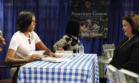 "U.S. first lady Michelle Obama attends a book signing of her first book ""American Grown"" at a book store in Washington, June 12, 2012. REUTERS/Jason Reed"