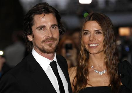 "British actor Christian Bale and his wife Sibi pose for photographers as they arrive at the European Premiere of ""The Dark Knight Rises"" in Leicester Square, central London, July 18, 2012. REUTERS/Andrew Winning"