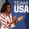 U.S. first lady Michelle Obama claps as she arrives at a Team USA athletes breakfast in London July 27, 2012. REUTERS/Mark Blinch