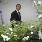 U.S. President Barack Obama walks from the Oval Office to the residence as he departs for a day trip to Ohio and New York, from the White House in Washington, June 14, 2012. REUTERS/Jonathan Ernst