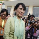 Myanmar pro-democracy leader Aung San Suu Kyi leaves Parliament after attending a meeting at the Lower House of Parliament in Naypyitaw July 9, 2012. REUTERS/Soe Zeya Tun