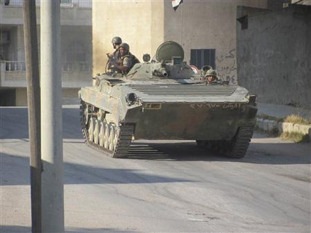 A tank belonging to forces loyal to Syria's President Bashar al-Assad is seen in Deraa July 24, 2012. Picture taken July 24, 2012. REUTERS/Shaam News Network/Handout