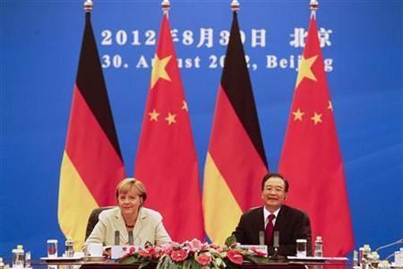 German Chancellor Angela Merkel (L) and Chinese Premier Wen Jiabao hold bilateral talks inside the Great Hall of the People in Beijing, August 30, 2012. REUTERS/Diego Azubel/Pool
