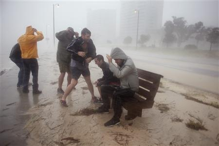 People try to get a look at the high surf along Beach Blvd. as Hurricane Isaac passes through Gulfport, Mississippi, August 29, 2012. REUTERS/Michael Spooneybarger