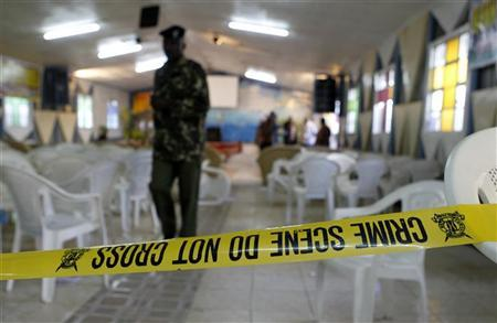 A policeman walks from the scene of an explosion inside the God's House Of Miracles International Church after a grenade attack in Nairobi April 29, 2012. REUTERS/Thomas Mukoya