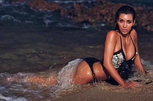 Kim Kardashian Shows Major Cleavage In Nocturnal Beach Photo Shoot
