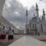 People walk in a square near Kul Sharif (also known as Qol Sharif) mosque in Kazan July 21, 2012. REUTERS/Roman Kruchinin