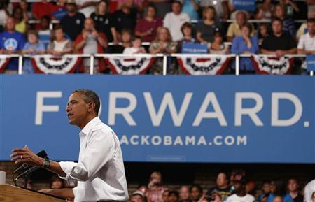U.S. President Barack Obama speaks at a campaign event at the B.R. Miller Middle School in Marshalltown, Iowa, August 14, 2012. REUTERS/Larry Downing