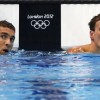Michael Phelps (L) and Ryan Lochte of the U.S. check their times after their men's 200m individual medley semi-final during the London 2012 Olympic Games at the Aquatics Centre August 1, 2012. REUTERS/David Gray