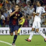 Barcelona's Xavi (L) celebrates after scoring a goal past Real Madrid's Sami Khedira during their Spanish Super Cup first leg soccer match at Nou Camp stadium in Barcelona August 23, 2012. REUTERS/Gustau Nacarino