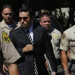 """Men believed to be attorneys hired by Nakoula Basseley Nakoula, who has been linked by news organizations to the production of the anti-Muslim video, """"Innocence of Muslims"""", arrive at the home in Cerritos, California on September 14, 2012. REUTERS/Patrick T. Fallon"""