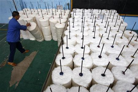 A labourer works at a cotton textile factory in Suining, Sichuan province October 27, 2010. REUTERS/Stringer