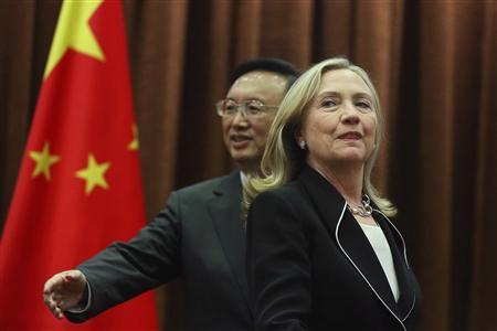 U.S. Secretary of State Hillary Clinton (R) reacts as China's Foreign Minister Yang Jiechi gestures during their meeting in Beijing September 4, 2012. REUTERS/Feng Li/Pool