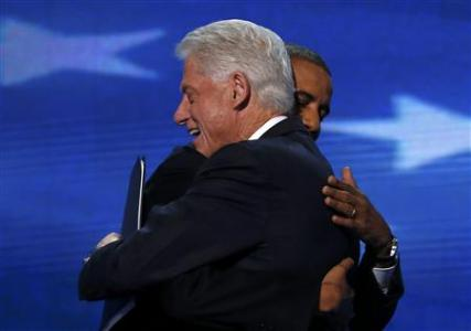 U.S. President Barack Obama (R) embraces former President Bill Clinton onstage after Clinton nominated Obama for re-election during the second session of the Democratic National Convention in Charlotte, North Carolina, September 5, 2012. REUTERS/Jim Young