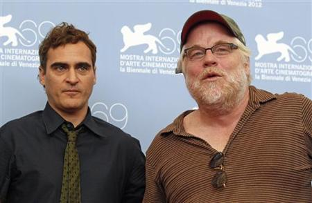 """U.S. actors Philip Seymour Hoffman (R) and Joaquin Phoenix pose during a photocall for the movie """"The Master"""" at the 69th Venice Film Festival September 1, 2012. REUTERS/Tony Gentile"""