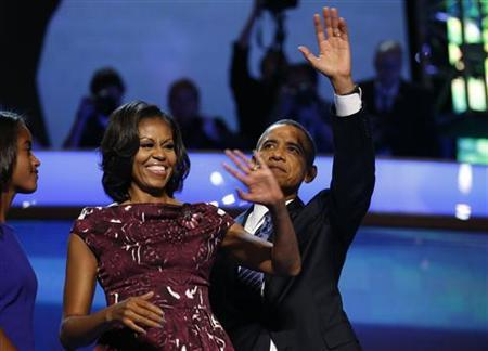 U.S. President Barack Obama celebrates with first lady Michelle Obama and his daughter Malia (L) after accepting the 2012 U.S Democratic presidential nomination during the final session of Democratic National Convention in Charlotte, North Carolina, September 6, 2012. REUTERS/Jim Young