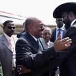 South Sudan's President Salva Kiir (R) welcomes Sudan's President Omar Hassan al-Bashir at Juba airport July 9, 2011. REUTERS/Benedicte Desrus