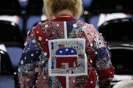 A delegate wearing a quilt shirt walks to her seat before the second session of the Republican National Convention in Tampa, Florida, August 28, 2012 REUTERS/Mike Segar