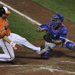 Baltimore Orioles base runner Taylor Teagarden (L) is tagged out by Toronto Blue Jays catcher J.P. Arencibia (R) in the sixth inning in their second game of a double header during an MLB American League baseball game in Baltimore, Maryland, September 24, 2012. REUTERS/Patrick Smith