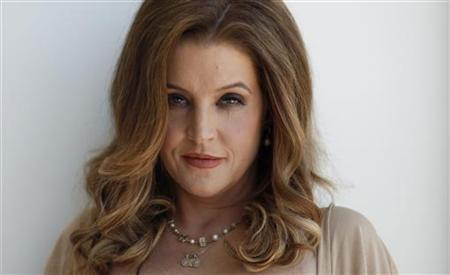 Music recording artist Lisa Marie Presley poses for a portrait in West Hollywood, California May 10, 2012. REUTERS/Mario Anzuoni