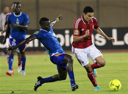 Gedo (R) of Egypt's Al-Ahly fights for the ball with Tosin Yunusa of Nigeria's Sunshine Stars during their African Champions League semi-final soccer match at the Military Stadium in Cairo October 21, 2012. REUTERS/Mohamed Abd El Ghany