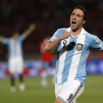 Argentina's Gonzalo Higuain celebrates after he scored a goal against Chile during their 2014 World Cup qualifying soccer match in Santiago October 16, 2012. REUTERS/Ivan Alvarado