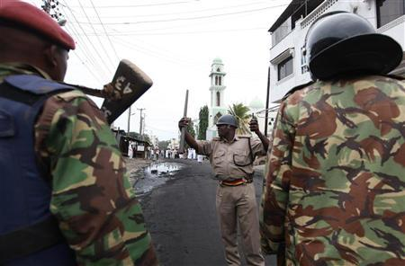 A policeman gives orders to his officers during a protest by Muslim faithful over the killing of Sheikh Aboud Rogo Mohammed, after Friday prayers at the Masjid Mussa mosque in the Kenyan coastal city of Mombasa, August 31, 2012. REUTERS/Joseph Okanga