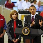 U.S. President Barack Obama (R) talks about damage done by Hurricane Sandy and rescue efforts while at the National Red Cross Headquarters in Washington October 30, 2012. REUTERS/Larry Downing