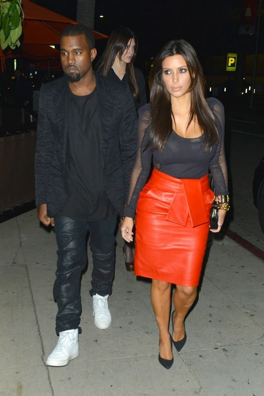 Kim Kardashian and Kanye West wear matching leather outfits in huge PDA kissing session