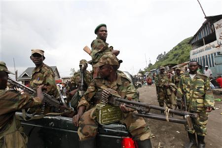 Congolese Revolution Army (CRA) rebels sit in a truck as they patrol a street in Sake, 25 km (15.5 miles) north of Goma city in the eastern Democratic Republic of Congo (DRC), November 21, 2012, soon after the rebels captured the town from the government army. The United Nations defended its failed effort to prevent rebels from seizing the Congolese city of Goma, saying on Wednesday its helicopters had fired hundreds of rockets at rebels but were unable to beat them back when their forces sharply increased. Advancing M23 rebels seized the city on Tuesday after soldiers from the Democratic Republic of Congo's army fled. REUTERS/James Akena