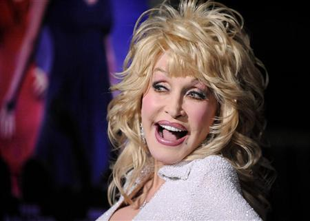 """Actress and singer Dolly Parton arrives at the Hollywood premiere of """"Joyful Noise"""" in Los Angeles, California January 9, 2012. REUTERS/Gus Ruelas"""
