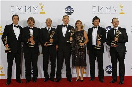 "Alex Gansa (C) and fellow writers pose with their award for outstanding writing for a drama series for ""Homeland,"" backstage at the 64th Primetime Emmy Awards in Los Angeles, September 23, 2012. REUTERS/Mario Anzuoni"