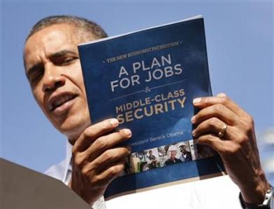 U.S. President Barack Obama holds up his plan for jobs during a campaign rally in Delray, Florida October 23, 2012. REUTERS/Kevin Lamarque